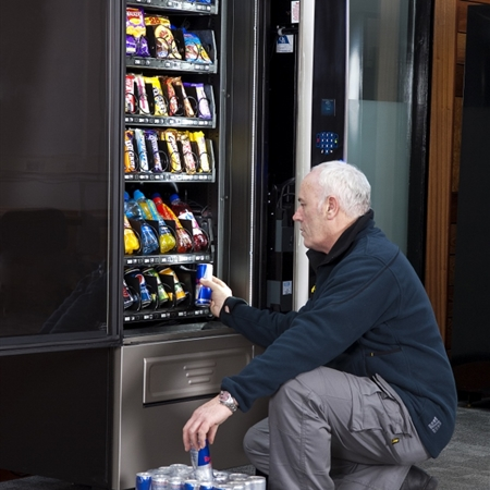Office Vending Machine being filled by Tony